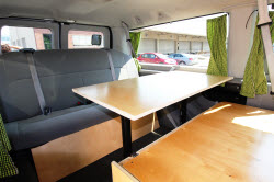 Comfy budget Ford campervans for rent with roof top tents in California and Utah